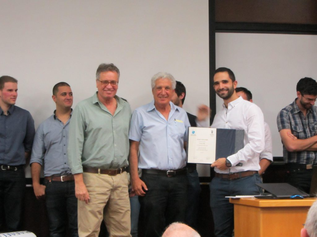 Eliran Eyal receiving a Certificate of Appreciation from Prof. Cohen and Dror Artzi