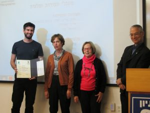 Ido Greenfeld receiving diploma and scholarship from the Zohar family