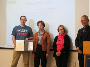 Rea David receiving diploma and scholarship from the Zohar family