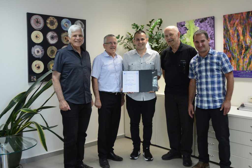 Shahar Wollmark with Prof. Boaz Golany, the Technion Vice President for External Relations and Resource Development, and Prof. Em. Avi Marmur, the Head of the Center for Security Science and Technology, and his supervisors Prof. Em. Alon Gany and Dr. Yinon Yavor